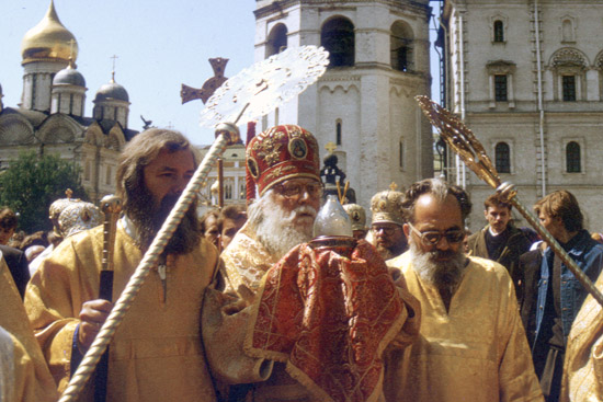 Bishop Basil in the Kremlin carrying the holy fire from Jerusalem, May 1991.