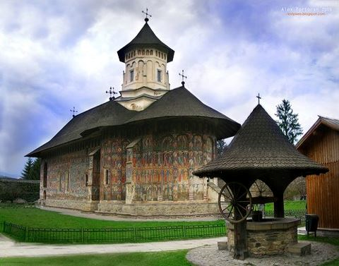 Magnificent external frescoes and icons on ancient Romanian monastery church