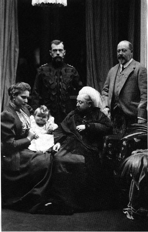 Here, Empress Alexandra (far left) sits with her husband (standing next to her) and her grandmother Queen Victoria (1819-1901, r. 1837-1901) on one of the Imperial couple's many visits to England. To Queen Victoria's left, standing beside her is her son and heir, Edward, Prince of Wales, the future Edward VII (r. 1901-1910).