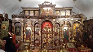 The beautiful wooden iconostasis.