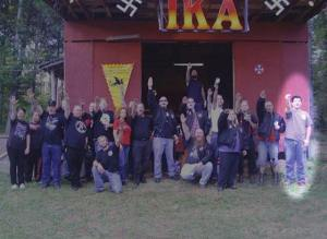 Matthew Heimbach (far right) at a meeting of the neo-Nazi IKA (Imperial Klans of America) meeting. Note the Nazi swastikas present.