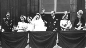 The British Royal Family greet throngs of well-wishers from the balcony at Buckingham Palace on 20 November 1947. From left are: King George VI, Princess Margaret, then-Princess Elizabeth, Prince Philip, Queen Elizabeth (the future Queen Mother), and Queen Mary (widow of George V and mother to George VI).